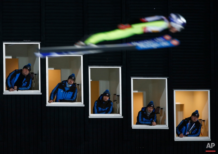 In this Sunday, Feb. 22, 2015 photo, United States' Sarah Hendrickson jumps past judges looking out of their tower windows during the Mixed Team Ski Jumping competition at the Nordic Skiing World Championships in Falun, Sweden. (AP Photo/Matthias Schrader)