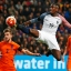 France's Paul Pogba just misses the ball as he tries to score during a international friendly soccer match between Netherlands and France at the ArenA stadium in Amsterdam, Netherlands, Friday, March 25, 2016. Left is Netherlands' Joel Veltman, right is Netherlands' Luuk de Jong. (AP Photo/Peter Dejong)