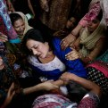 Women try to comfort a mother who lost her son in bomb attack in Lahore, Pakistan, Monday, March 28, 2016. The death toll from a massive suicide bombing targeting Christians gathered on Easter in the eastern Pakistani city of Lahore rose on Monday as the country started observing a three-day mourning period following the attack. (AP Photo/K.M. Chaudary)