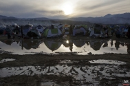 Migrants living in tents at a flooded field at the northern Greek border station of Idomeni, Tuesday, March 8, 2016. (AP Photo/Visar Kryeziu)