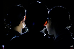 Fashion models pose for a selfie in front of a spotlight backstage at China Fashion Week in Beijing, Friday, March 25, 2016. (AP Photo/Mark Schiefelbein)