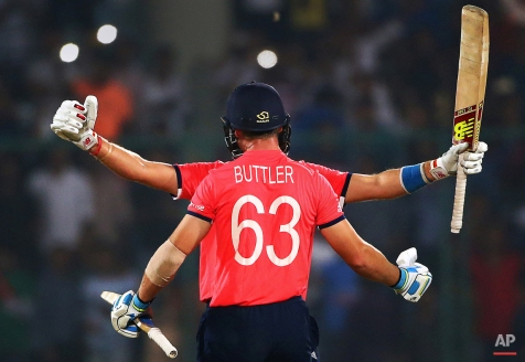 England's Jos Buttler, and teammate Joe Root, face hidden, celebrate after defeating New Zealand during their ICC Twenty20 2016 Cricket World Cup semifinal match at the Feroz Shah Kotla Cricket Stadium in New Delhi, India, Wednesday, March 30, 2016. England win by seven wickets. (AP Photo/Manish Swarup)