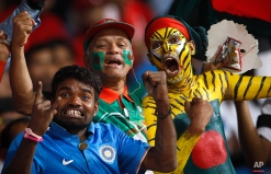 Indian and Bangladeshi fans cheer for their teams before the start of ICC World Twenty20 2016 cricket match between India and Bangladesh in Bangalore, India, Wednesday, March 23, 2016. (AP Photo/Aijaz Rahi)