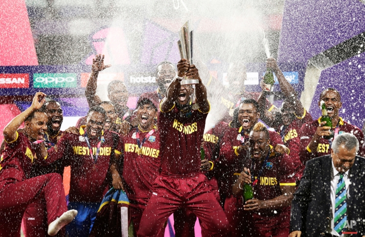 West Indies players celebrate on the podium after defeating England in the final of the ICC World Twenty20 2016 cricket tournament at Eden Gardens in Kolkata, India, Sunday, April 3, 2016. (AP Photo/Saurabh Das)