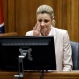 Sportscaster and television host Erin Andrews testifies Tuesday, March 1, 2016, in Nashville, Tenn. Andrews has filed a $75 million lawsuit against the franchise owner and manager of a luxury hotel and a man who admitted to making secret nude recordings of her in 2008. (AP Photo/Mark Humphrey, Pool)