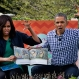"""President Barack Obama and first lady Michelle Obama make claw hands and monster faces while reading, """"Where The Wild Things Are,"""" during White House Easter Egg Roll at the White House in Washington, Monday, March 28, 2016. Thousands of children gathered at the White House for the annual Easter Egg Roll. This year's event features live music, sports courts, cooking stations, storytelling, and Easter egg rolling. (AP Photo/Jacquelyn Martin)"""