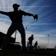Milwaukee Brewers players throw during a spring training baseball workout Tuesday, March 1, 2016, in Phoenix. (AP Photo/Morry Gash)