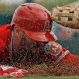 Los Angeles Angels' Johnny Giavotella slides safely past Los Angeles Angels third baseman Jefry Marte for a triple during the second inning of a spring training baseball game Sunday, March 6, 2016, in Tempe, Ariz. (AP Photo/Morry Gash)