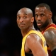 Los Angeles Lakers' Kobe Bryant, left, and Cleveland Cavaliers' LeBron James wait for play to resume during the first half of an NBA basketball game Thursday, March 10, 2016, in Los Angeles. (AP Photo/Danny Moloshok)