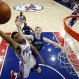 Philadelphia 76ers' Ish Smith (1) goes up for a shot against Charlotte Hornets' Cody Zeller (40) during the first half of an NBA basketball game, Tuesday, March 29, 2016, in Philadelphia. (AP Photo/Matt Slocum)