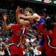New York Knicks center Robin Lopez, center, loses the ball as he is fouled by Washington Wizards center Nene (42), from Brazil, with Wizards forward Otto Porter Jr. (22) nearby during the first half of an NBA basketball game Saturday, March 19, 2016, in Washington. (AP Photo/Alex Brandon)