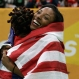 United States' Nia Ali, right, celebrates with United States' Brianna Rollins, left, after Ali won the women's 60-meter hurdles final and Rollins finished second during the World Indoor Athletics Championships, Friday, March 18, 2016, in Portland, Ore. (AP Photo/Elaine Thompson)