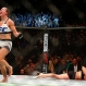 Miesha Tate, left, celebrates victory over Holly Holm in their UFC 196 women's bantamweight mixed martial arts match, Saturday, March 5, 2016, in Las Vegas. (AP Photo/Eric Jamison)