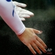 Amy Tinkler, of Great Britain, chalks her hands before competing on the vault during the 2016 AT&T American Cup gymnastics competition, Saturday, March 5, 2016, in Newark, N.J. (AP Photo/Julio Cortez)