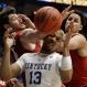 Kentucky's Isaiah Briscoe, center, Alabama's Riley Norris, left, and Michael Kessens, right, battle for a rebound during the first half of an NCAA college basketball game in the Southeastern Conference tournament in Nashville, Tenn., Friday, March 11, 2016. (AP Photo/Mark Humphrey)