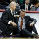 Virginia head coach Tony Bennett is attended to after Bennett collapsed during play against Hampton during the first half of a first-round men's college basketball game in the NCAA Tournament, Thursday, March 17, 2016, in Raleigh, N.C. (AP Photo/Chuck Burton)