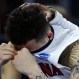 Arizona guard Gabe York hides his emotions as a teammate rests his hand on his head in the closing minute against Wichita State during the first round of the NCAA college men's basketball tournament in Providence, R.I., Thursday, March 17, 2016. Wichita State defeated Arizona 65-55. (AP Photo/Charles Krupa)