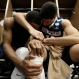 Gonzaga's Eric McClellan (23) and Josh Perkins (13) embrace in the locker room after an NCAA college basketball game in the regional semifinals of the NCAA Tournament, Friday, March 25, 2016, in Chicago. Syracuse won 63-60. (AP Photo/Nam Y. Huh)