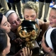 South Greene players kiss and celebrate as they hold the trophy after their 61-55 win against Gibson County in the Tennessee Division I A girls high school basketball championship game Saturday, March 12, 2016, in Murfreesboro, Tenn. (AP Photo/Mark Zaleski)
