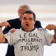 Republican presidential candidate Donald Trump rubs the shoulders of Alex Stypik, as Stypik shows off his T-shirt during a rally Sunday, March 13, 2016, in Bloomington, Ill. (AP Photo/Charles Rex Arbogast)