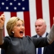 """Democratic presidential candidate Hillary Clinton acknowledges the crowd as she arrives to speak at a """"Get Out The Vote"""" campaign rally in Norfolk, Va., Monday, Feb. 29, 2016. (AP Photo/Gerald Herbert)"""