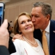 Republican presidential candidate Ohio Gov. John Kasich kisses the cheek of Kay Ward of Louisville, Miss., as she has her photo taken prior to addressing a Central Mississippi Republican Party fund raising dinner in Jackson, Miss., Tuesday, March 1, 2016. (AP Photo/Rogelio V. Solis)