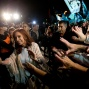 In this April 11, 2016 photo, former Argentina's President Cristina Fernandez, left, is greeted by followers upon her arrival at the airport in Buenos Aires, Argentina. After spending four months in Patagonia, Fernandez' supporters gave her a hero's welcome at a Buenos Aires airport before she faces a court over her possible role in an alleged scheme to manipulate the country's currency. (AP Photo/Natacha Pisarenko)