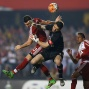 In this April 13, 2016 photo, Lucas Nicolas Alario of Argentina's River Plate, left, fights for the ball with goalkeeper Denis of Brazil's Sao Paulo FC during a Copa Libertadores soccer match in Sao Paulo. (AP Photo/Andre Penner)