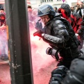A policeman reacts during a clash with protestors during a protest against the proposed changes to France's working week and layoff practices, in Lyon, central France, Thursday, April 28, 2016. French protesters are back on the streets over proposed reforms to the country's labor rules and strikers have forced cancellations and delays at two airports serving Paris. (AP Photo/Laurent Cipriani)