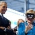 U.S. President Barack Obama looks on as GermanChancellor Angela Merkel tests VR goggles when touring the Hannover Messe, the world's largest industrial technology trade fair, in Hannover, northern Germany, Monday, April 25, 2016. Obama is on a two-day official visit to Germany. (AP Photo/Carolyn Kaster)