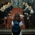 A visitor views The Somerset House Conference painting at the exhibition of English portraits in the Tretyakov Gallery in Moscow, Thursday, April 21, 2016. The exhibition from the collection of the National Portrait Gallery in London opened at the gallery and includes major British works. (AP Photo/Alexander Zemlianichenko)