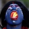 An Indian man dressed as the Hindu Goddess Kali puts fire in his mouth during a procession to celebrate the Ram Navami festival in Allahabad, India, Friday, April 15, 2016. Hindu devotees celebrate the festival of Ram Navami, the birth anniversary of Lord Rama, which also marks the end of the nine-day long fasting and Navaratri festival. (AP Photo/Rajesh Kumar Singh)