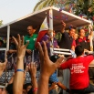 Presidential candidate Mayor Rodrigo Duterte, third right, throws rubber wristbands to supporters as his campaign motorcade makes its way through the streets of Malabon, Wednesday, April 27, 2016, north of Manila, Philippines. The tough-talking Duterte, the mayor of the southern Philippine city of Davao, is the front-running candidate leading to the May 9 presidential elections. (AP Photo/Bullit Marquez)