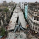 In this Friday, April 1, 2016 photo, a general view shows a partially collapsed overpass in Kolkata, India. The overpass spanned nearly the width of the street and was designed to ease traffic through the densely crowded Bara Bazaar neighborhood in the capital of the east Indian state of West Bengal. About 100 meters (300 feet) of the overpass fell, while other sections remained standing. (AP Photo/Bikas Das)