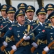 A honor guard shouts during a welcome ceremony for Australian Prime Minister Malcolm Turnbull, unseen, outside the Great Hall of the People in Beijing, Thursday, April 14, 2016. Australian Prime Minister Malcolm Turnbull hailed business ties with China but skirted sensitive political issues Thursday, on the first day of an official visit to his country's key trade partner. (AP Photo/Ng Han Guan)