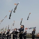 Members of a South Korean military honor guard throw their guns into the air during a weekly demonstration at the War Memorial of Korea in Seoul, South Korea, Friday, April 8, 2016. The honor guard's demonstration resumed Friday as it was suspended in winter, and their performances in the honor guard ceremony attract foreign tourists and local visitors every year. (AP Photo/Lee Jin-man)