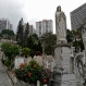 Worshippers walk at a cemetery to visit the grave of their families' ancestors during the Chinese Ching Ming, or Tomb Sweeping Day, in Hong Kong, Monday, April 4, 2016. Thousands of Hong Kong residents pay respects to their dead ancestors and relatives during the festival. (AP Photo/Vincent Yu)
