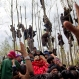 Kashmiri Muslims try to get a glimpse of the body of Waseem Malla, a suspected militant of Hizbul Mujahideen, during his funeral procession in Pehlipora, some 60 kilometers (35 miles) south of Srinagar, Indian controlled Kashmir, Thursday, April 7, 2016. Anti-India protesters attacked government forces with rocks and burned an armored vehicle Thursday as they participated in the funerals of two insurgents killed in a gunbattle in the disputed Kashmir region, an Indian official said. (AP Photo/Dar Yasin)