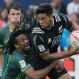 In this April 10, 2016 photo, New Zealand's Regan Ware, right, is tackled by South Africa's Cecil Afrika, left, during the semifinal match at the Hong Kong Sevens rugby tournament in Hong Kong. The NBA joins a long list of sports leagues that sells advertising space on their jerseys. (AP Photo/Kin Cheung)