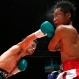 Japanese champion Kohei Kono, left, sends a right to Thai challenger Inthanon Sithchamuang in the ninth round of their WBA world super flyweight boxing title match in Tokyo, Wednesday, April 27, 2016. Kono defended his title on a unanimous decision. (AP Photo/Toru Takahashi)