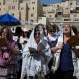 """Jewish women wear prayer shawls as they pray during the Jewish holiday of Passover in front of the Western Wall, the holiest site where Jews can pray, in Jerusalem's Old City, Sunday, April 24, 2016. A liberal women's group has held a special Passover prayer service at a Jerusalem holy site, drawing criticism from the site's ultra-Orthodox rabbi, who called it a """"provocation."""" (AP Photo/Ariel Schalit)"""