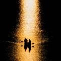 Canoers on the Potomac River pause to watch the sunset in Washington on Sunday, April 3, 2016. (AP Photo/J. David Ake)