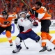 Philadelphia Flyers' Colin McDonald, right, and Washington Capitals' Matt Niskanen, center, collide as Ryan White skates past during the second period of Game 4 in the first round of the NHL Stanley Cup hockey playoffs, Wednesday, April 20, 2016, in Philadelphia. (AP Photo/Matt Slocum)