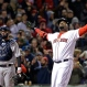 Boston Red Sox designated hitter David Ortiz celebrates his two-run homer as New York Yankees catcher Brian McCann watches in the eighth inning of a baseball game at Fenway Park on Friday, April 29, 2016, in Boston. The Red Sox won 4-2. (AP Photo/Elise Amendola)