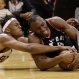 Indiana Pacers' Myles Turner (33) and Toronto Raptors' Bismack Biyombo (8) battle for a loose ball during the second half of Game 4 of an NBA first-round playoff basketball series, Saturday, April 23, 2016, in Indianapolis. Indiana won 100-83. (AP Photo/Darron Cummings)