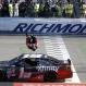 Carl Edwards does a backflip off his car after winning the Sprint Cup auto race at Richmond International Raceway in Richmond, Va., Sunday, April 24, 2016. (AP Photo/Chet Strange)
