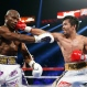 Manny Pacquiao, right, of the Philippines, hits Timothy Bradley during their WBO welterweight title boxing bout Saturday, April 9, 2016, in Las Vegas. (AP Photo/Isaac Brekken)