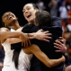 Connecticut's Morgan Tuck, left rear, Moriah Jefferson, front left, and Breanna Stewart hug Connecticut head coach Geno Auriemma, right, following their championship game against Syracuse in the women's Final Four in the NCAA college basketball tournament, Tuesday, April 5, 2016, in Indianapolis. Connecticut won 82-51. (AP Photo/AJ Mast)