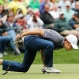Jordan Spieth blows on his ball on the ninth hole during the par three competition at the Masters golf tournament, Wednesday, April 6, 2016, in Augusta, Ga. (AP Photo/David J. Phillip)
