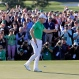Danny Willett, of England, celebrates on the 18th hole after finishing the final round of the Masters golf tournament, Sunday, April 10, 2016, in Augusta, Ga. (AP Photo/Charlie Riedel)